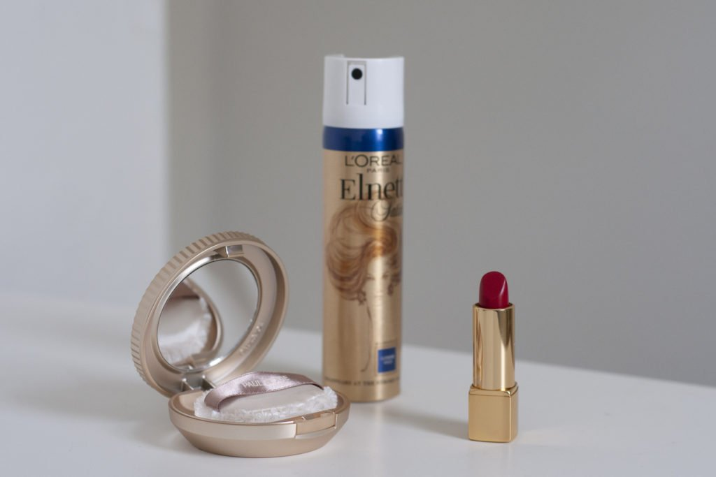Bridal touch up kit with powder, hairspray and lipstick