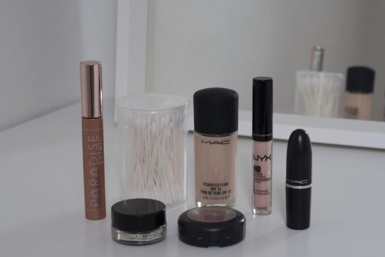 A range of makeup products in front of a mirror
